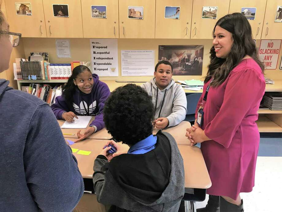 New Haven Teacher of the Year 2019 Lauren Sepulveda helps facilitate a trivia game with her class of eighth graders at Clinton Avenue School on Friday, Nov. 30. Photo: Brian Zahn / Hearst Connecticut Media