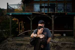 Gayle Edgar, 45 and her husband Doug Edgar, 58 embrace for a portrait outside their home that survived the Camp Fire in Chico, California, on Wednesday, Nov. 28, 2018. The couple stayed until 6pm on the day of the fire and believe a hand crew single-handedly saved their house. Their shed, with a motorcycle and many mementos burned down.