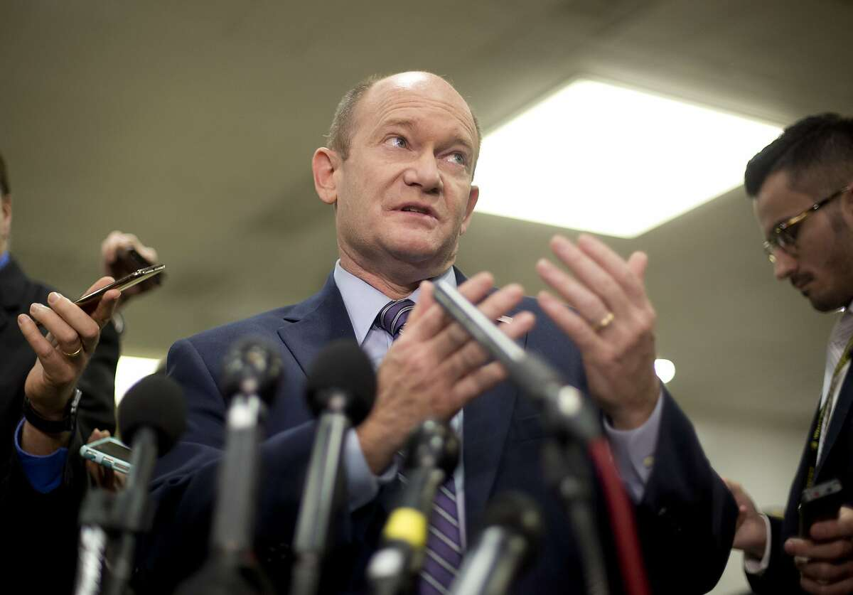 Sen. Chris Coons, D-Del., gestures while speaking to members of the media after leaving a closed door meeting about Saudi Arabia, Wednesday, Nov. 28, 2018, on Capitol Hill in Washington. (AP Photo/Pablo Martinez Monsivais)