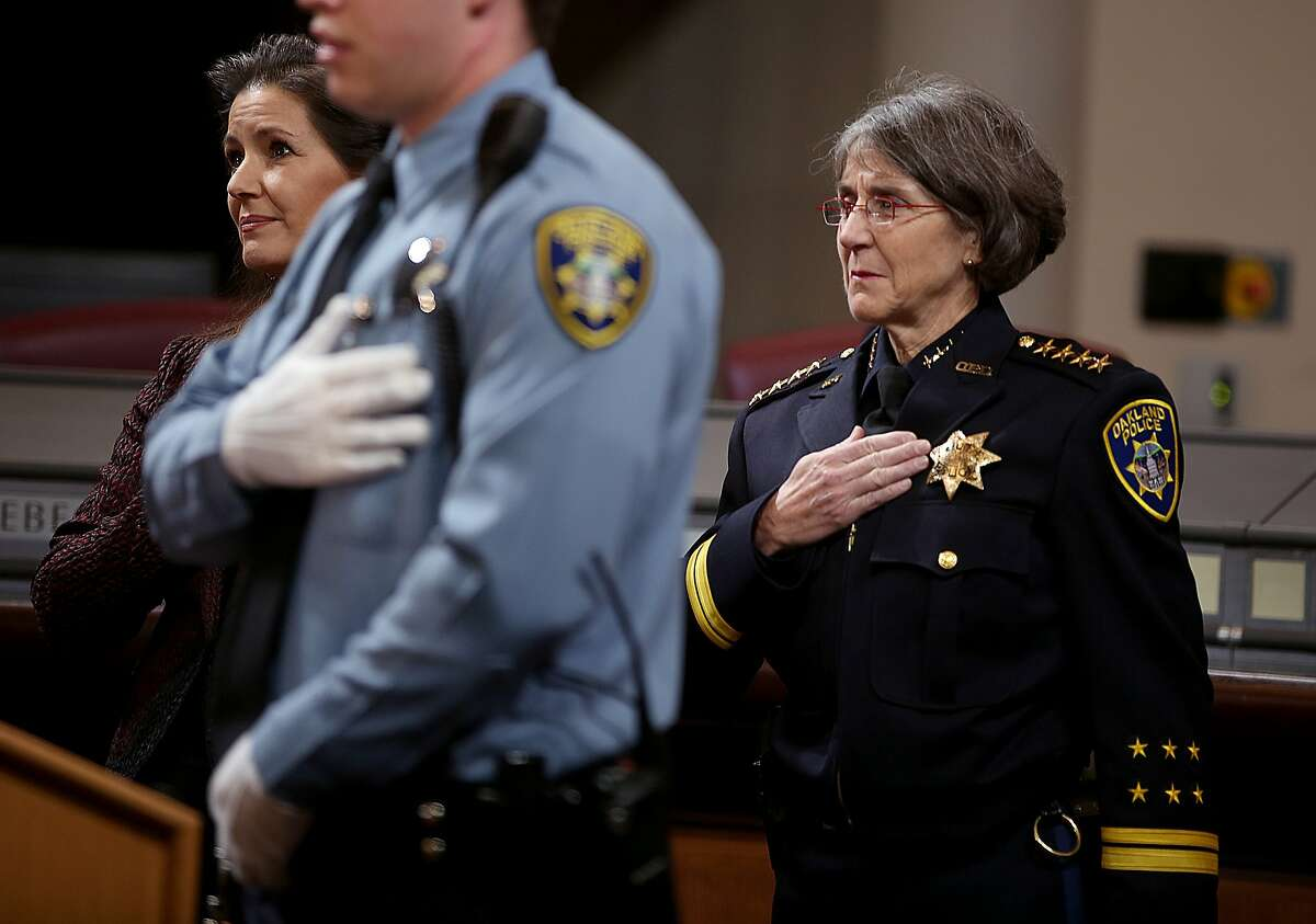 Mayor Libby Schaaf (left), police cadet Colin Gilchrist (middle), and Anne E. Kirkpatrick (right) do the pledge of allegiance before she gets sworn in as Oakland?•s permanent Chief of Police at an Oakland City Hall ceremony on Friday, February 27, 2017, in Oakland, Calif.