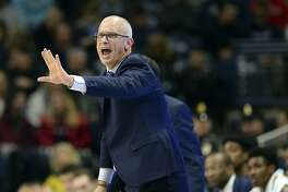 Connecticut head coach Dan Hurley directs his team during the second half of an NCAA basketball game against UMass-Lowell Tuesday, Nov. 27, 2018, in Storrs, Conn. (AP Photo/Stephen Dunn)