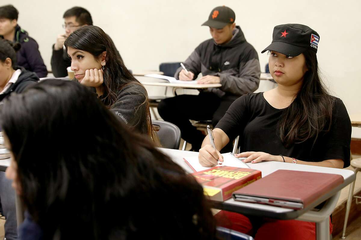 """City College of SF student, an Asian American studies major and community organizer Win-Mon Aung Kyi (right) attends her Cultural Geography class at CCSF on Friday, Nov. 30, 2018, in San Francisco, Calif. She has been active in trying to get the """"Free City"""" program (no tuition for SF residents) extended for 10 more years."""