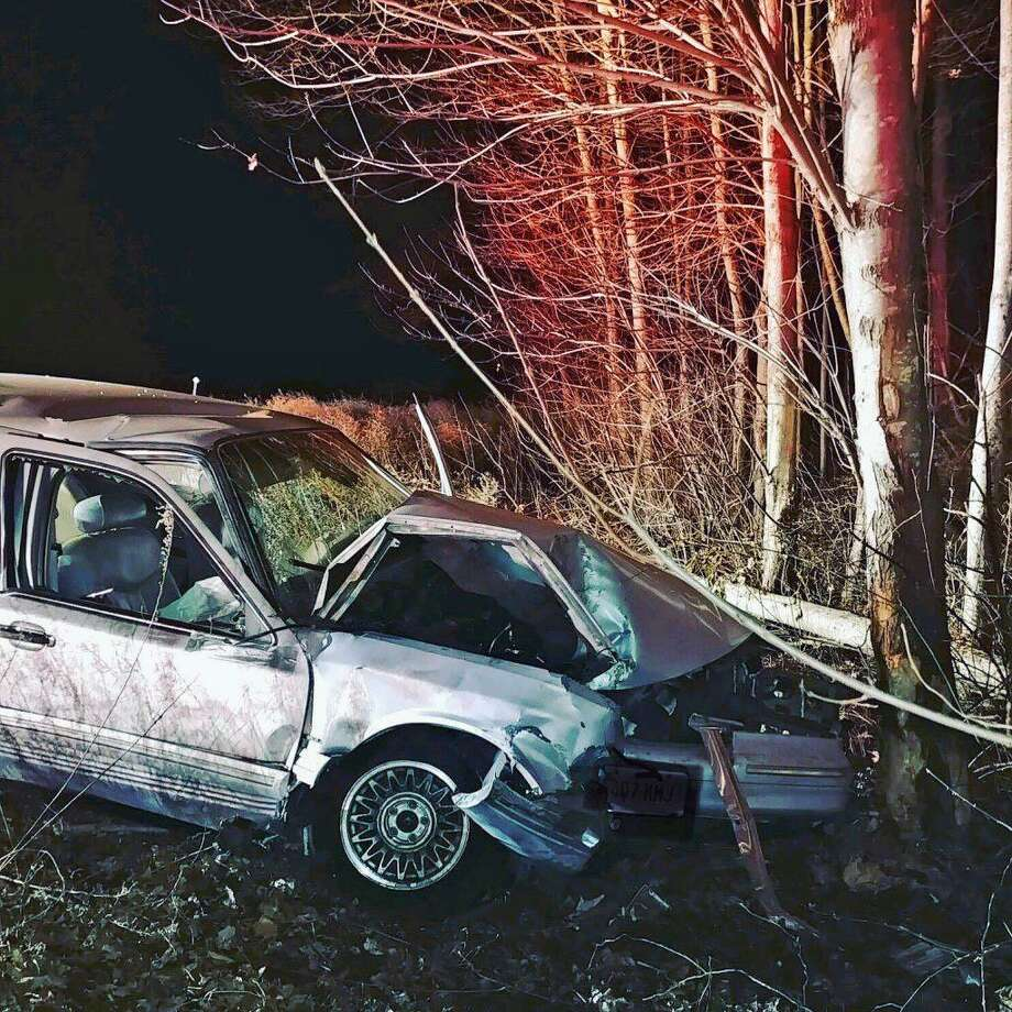 Shelton, Conn., firefighters responded to a one-car crash where the car left the highway and collided with a tree on Nov. 29, 2018. Photo: Contributed Photo / Shelton Echo Hose Fire Company / Contributed Photo / Connecticut Post Contributed