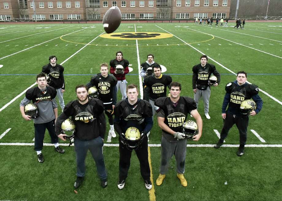 The Hand defense, front row from left: Defensive end Jack Flanagan, defensive tackle Macken McDonald, and defensive end Ben Corniello. Center row, from left: Outside linebacker Colin McCabe, inside linebacker Luke Wagner, inside linebacker Kevin Girardi, inside linebacker Shane Reiner. Not pictured is outside linebacker Kade Doverspike. Back row, from left: Cornerback Isaiah McNeilly, safety Tom Ferrick, safety Julian Banbrji, and linebacker Ian Butler. Photo: Peter Hvizdak / Hearst Connecticut Media / New Haven Register