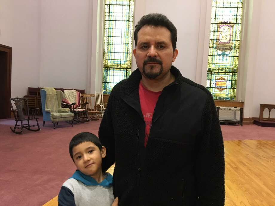 Nelson Pinos and his son Brandon, 6, at  First and Summerfield United Methodist Church in New Haven. Photo: Mary E. O'Leary / Hearst Connecticut Media /