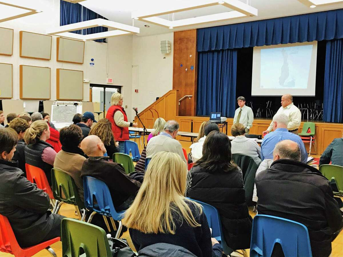 At the microphone, Fairfield resident Sue Olsen expresses frustrations with flooding on Littlebrook Road at a meeting on Nov. 29, 2018. The meeting covered the topic of flooding from a storm on Sept. 25, 2018.