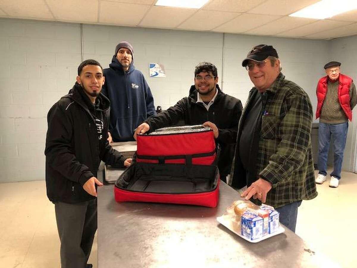 From left, Hiram Aponte, Center Subaru, Kevin McHugh, Lindley Food Service, Josh Rodriguez, Center Subaru, Joe Dante, Meals on Wheels driver. In the background is Dan Coleman, Meals on Wheels driver.