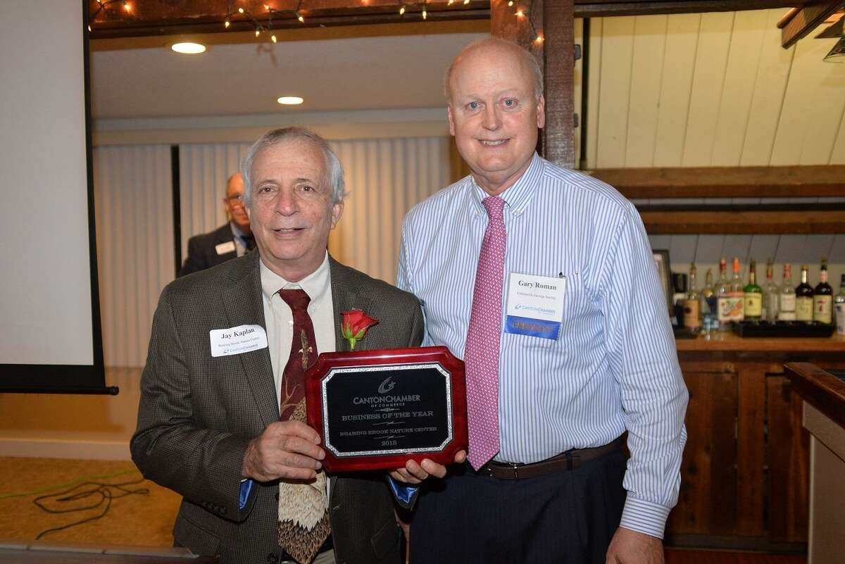 """The Canton Chamber of Commerce held its fourth annual """"Stars of the Town"""" celebration and dinner on Thursday, Nov. 1. The honorees included Roaring Brook Nature Center as the business of the year. The award was presented by Chamber of Commerce President, Gary J. Roman to longtime director of the nature center, Jay Kaplan."""