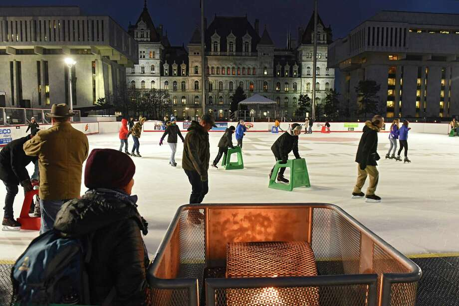 People enjoy ice skating during opening of the first day of the ice rink at the Empire State Plaza on Friday, Nov. 30, 2018 in Albany, N.Y. (Lori Van Buren/Times Union) Photo: Lori Van Buren / 40045475A