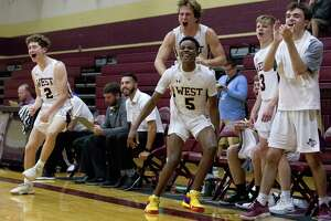 Magnolia West players react after a three-pointer during the fourth quarter of a non-district high school basketball game at Magnolia West High School, Friday, Nov. 30, 2018, in Magnolia.