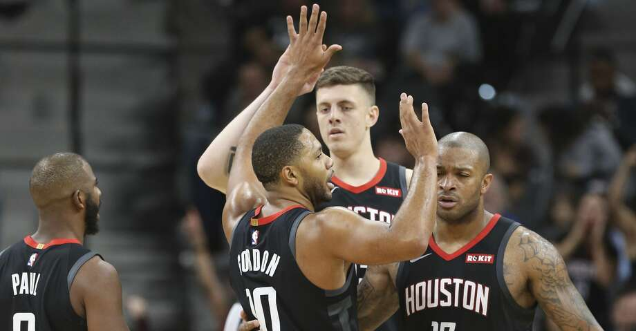 Houston Rocket's Eric Gordon (10) gets congratulated by teammates after scoring against the Spurs in the first half at the AT&T Center on Friday, Nov. 30, 2018. (Kin Man Hui/San Antonio Express-News) Photo: Kin Man Hui/San Antonio Express-News