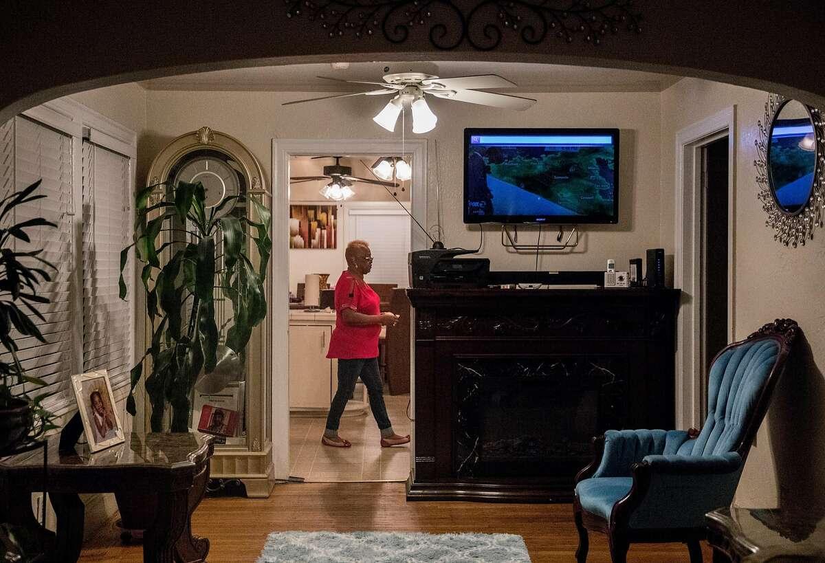 Karen Chaney cooks dinner after work at her home in Oakland, Calif. Tuesday, Nov. 27, 2018.
