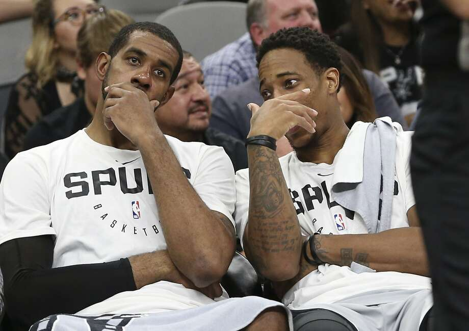 Spurs' LaMarcus Aldridge (left) and DeMar DeRozan (right) talk on the bench near the end of the game against the Houston Rockets at the AT&T Center on Friday, Nov. 30, 2018. Rockets defeated the Spurs, 136-105. (Kin Man Hui/San Antonio Express-News) Photo: Kin Man Hui, San Antonio Express-News