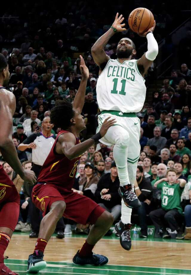 Boston Celtics guard Kyrie Irving (11) shoots over Cleveland Cavaliers guard Collin Sexton (2) during the first half of an NBA basketball game Friday, Nov. 30, 2018, in Boston. (AP Photo/Elise Amendola) Photo: Elise Amendola / Copyright 2018 The Associated Press. All rights reserved