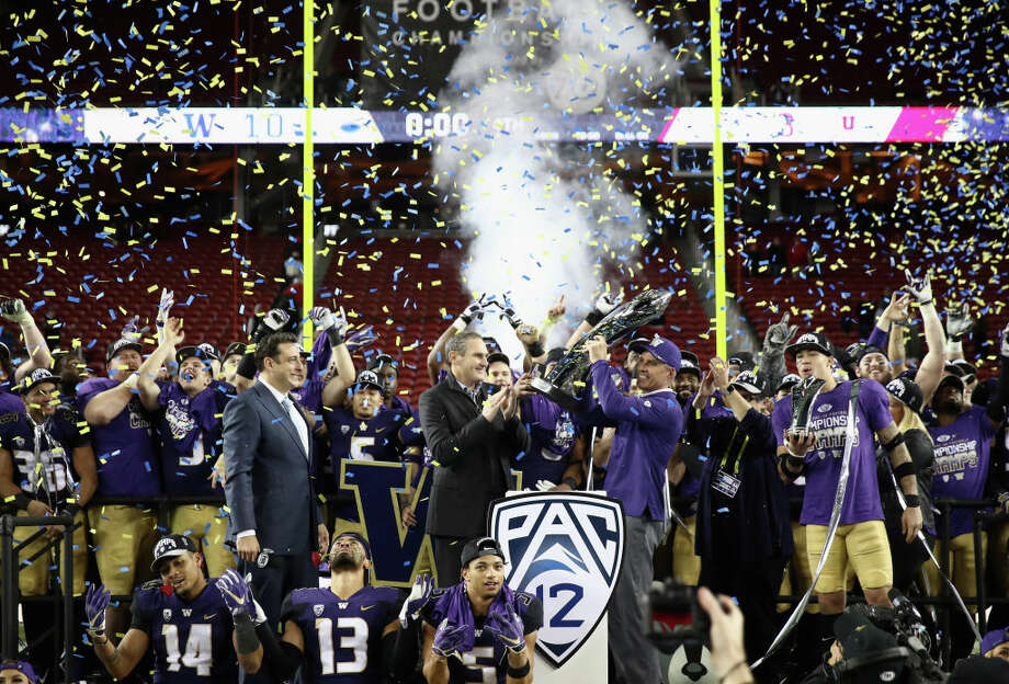 SANTA CLARA, CA - NOVEMBER 30:  Head coach Chris Petersen of the Washington Huskies is given the championship trophy after the Huskies beat the Utah Utes to win the Pac 12 Championship game at Levi's Stadium on November 30, 2018 in Santa Clara, California.  (Photo by Ezra Shaw/Getty Images) Photo: Ezra Shaw/Getty Images / 2018 Getty Images