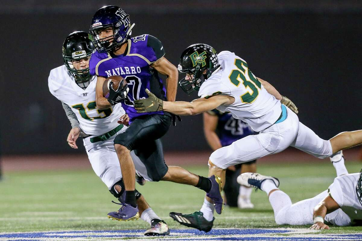 Navarro's Johnny Alegria, center, scored two touchdowns in Friday's 42-14 victory over Wimberley, but he also contributed an interception on defense. He was one of several offensive stars who made key defensive plays in the win.