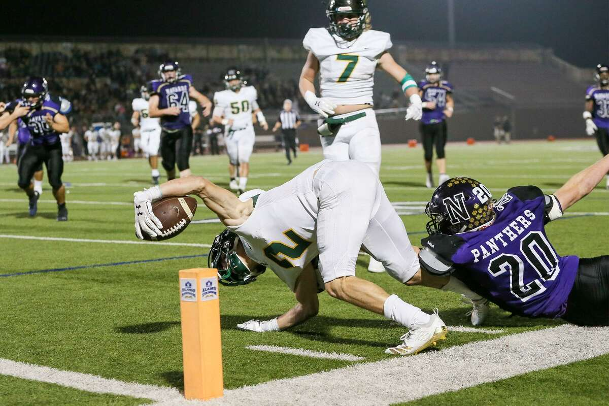 Rockport-Fulton's Chase Rios stretches for the end-zone as Navarro's Jason McCrary (right) tries to stop him during the second half of their third round Class 4A Division II high school football game at Alamo Stadium on Friday, Nov. 30, 2018.