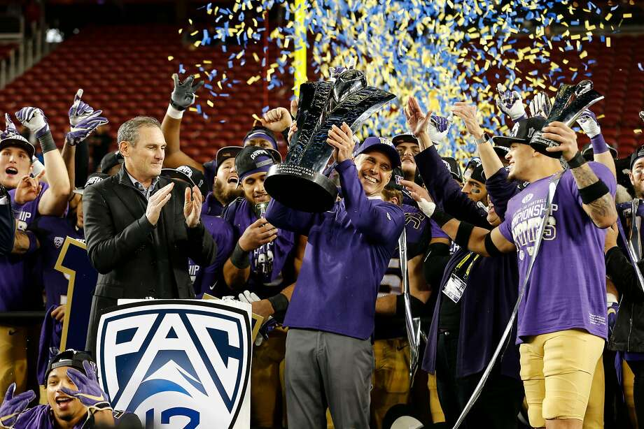 Washington Huskies head coach Chris Petersen hoists the trophy following the Pac-12 Football Championship game at Levi's Stadium on Friday, Nov. 30, 2018, in Santa Clara, Calif. The Washington Huskies won the game against the Utah Utes 10-3. Photo: Santiago Mejia, The Chronicle