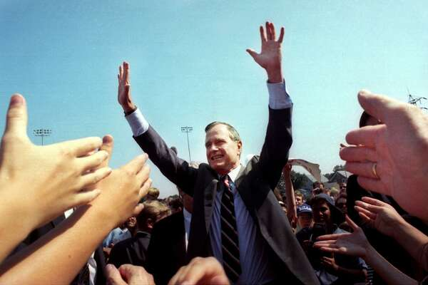 President George H. W. Bush greets the crowd gathered at Nolan Field in Ansonia, Conn. Aug. 24th, 1992.