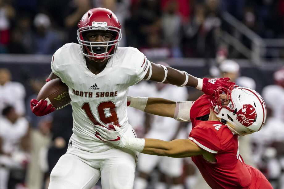 North Shore receiver Shadrach Banks (19) stiff arms Katy defensive back Kaden Gonzales (4) after making a catch in the middle of the field in the first half of a Class 6A Div. I Semi-Final high school football playoff game at NRG Stadium on Friday, Nov 30, 2018, in Houston. Photo: Joe Buvid/Contributor