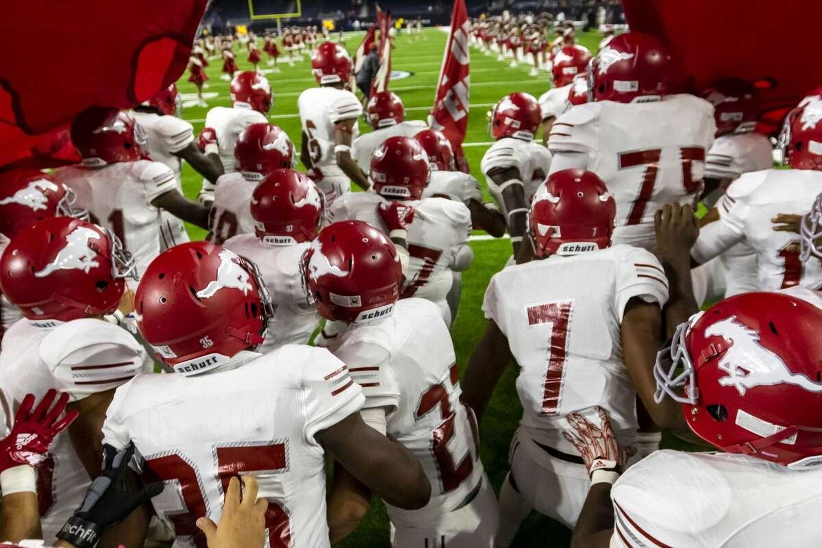 North Shore breaks through the banner and runs onto the field before a Class 6A Div. I Semi-Final high school football playoff game at NRG Stadium on Friday, Nov 30, 2018, in Houston.