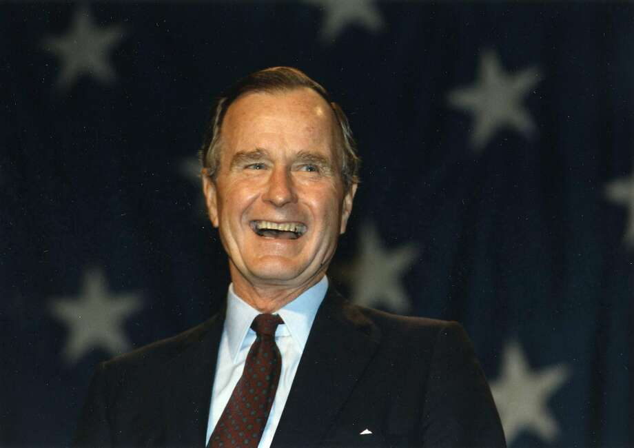 FILE — President Bush addresses the Engler for Governor Rally at the Amway Grand Center in Grand Rapids, Michigan on Oct. 16,1990 (Photo Credit:  George Bush Presidential Library and Museum)