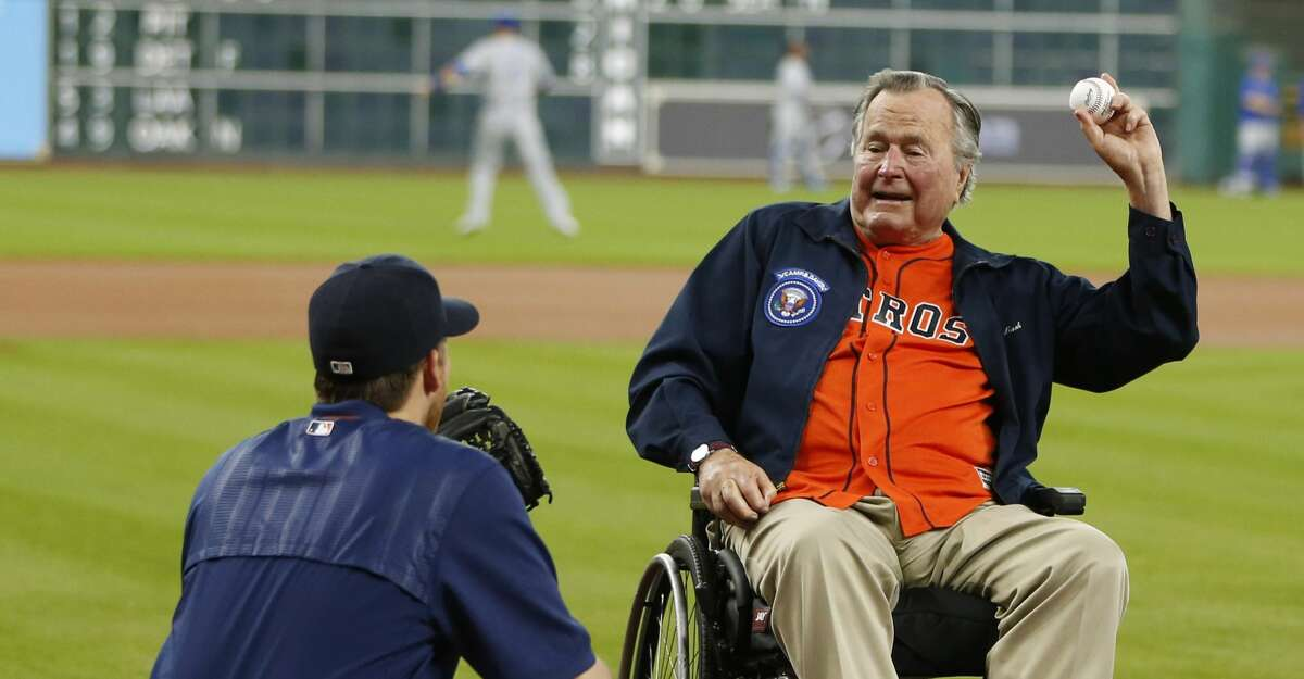 Former President George Bush prepares throws out the first pitch to Houston Astros starting pitcher Collin McHugh during the first inning of an MLB game at Minute Maid Park, Tuesday, April 12, 2016, in Houston. ( Karen Warren / Houston Chronicle )
