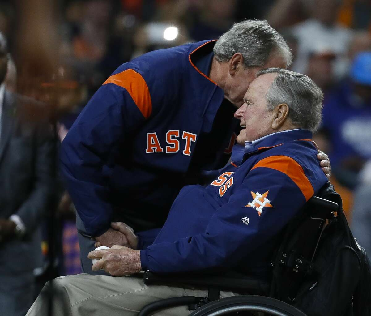 Former President George H.W. Bush and his son, former President George W. Bush, throw out the first pitch of Game 5 of the World Series to at Minute Maid Park on Sunday, Oct. 29, 2017, in Houston. ( Karen Warren / Houston Chronicle )