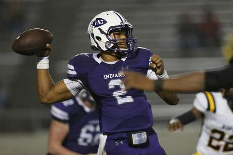 Port Neches-Groves Indians quarterback Roschon Johnson (C) (2) throws a pass in the third quarter during the high school football playoff game between the Port Neches-Groves Indians and the Fort Bend Marshall Buffalos in Baytown, TX on Friday, November 30, 2018.