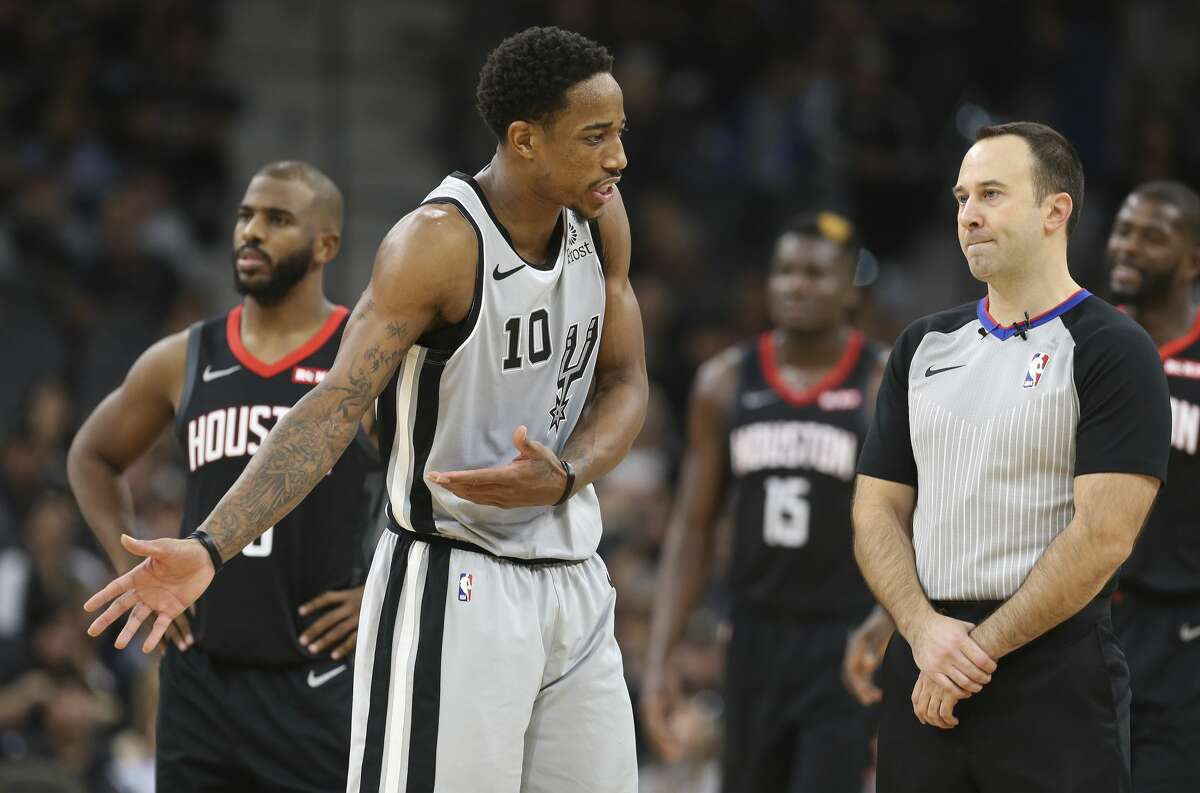 Spurs' DeMar DeRozan (10) attempts to discuss a technical foul with game official Kane Fitzgerald (right) during the second of the game against the Houston Rockets at the AT&T Center on Friday, Nov. 30, 2018. Rockets defeated the Spurs, 136-105. (Kin Man Hui/San Antonio Express-News)
