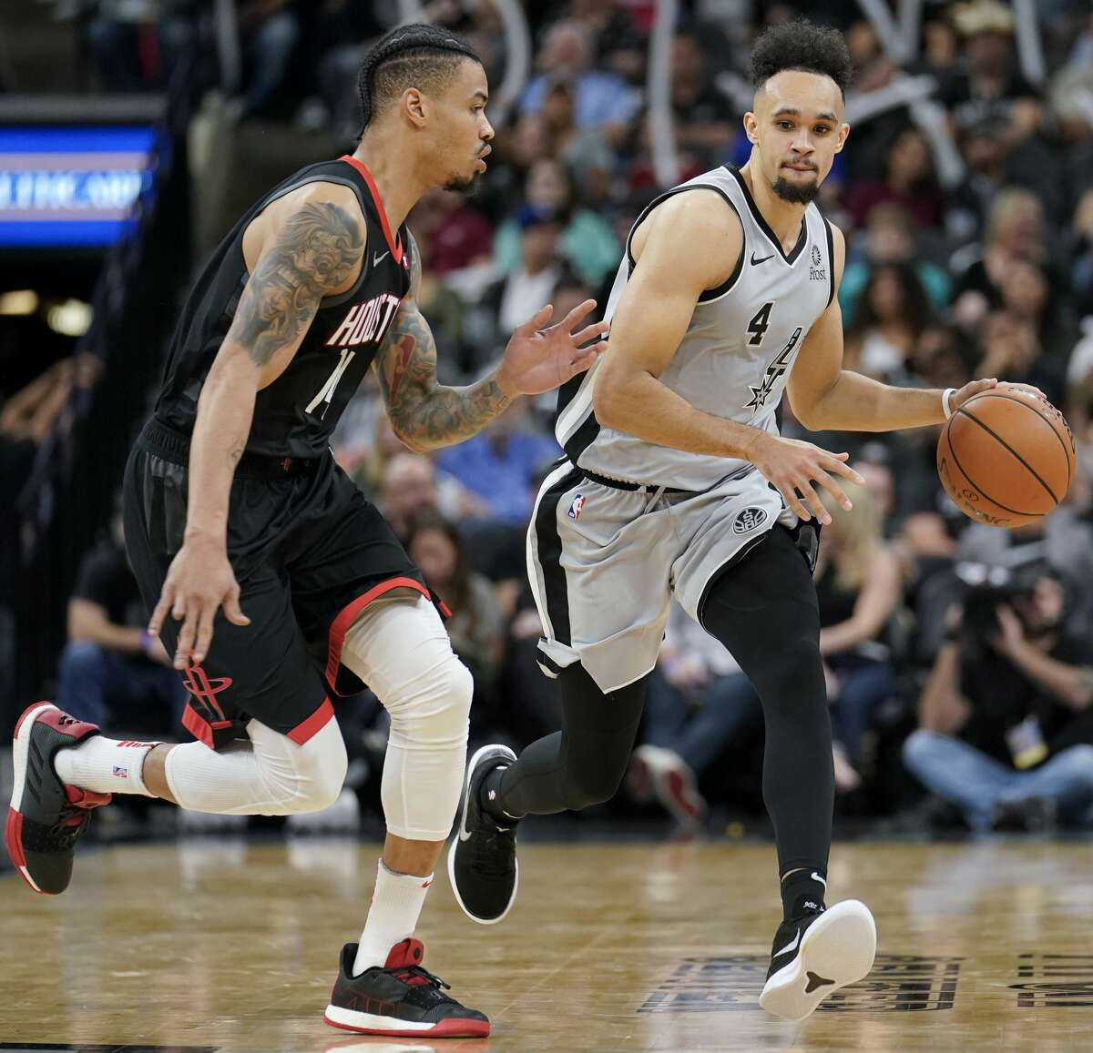San Antonio Spurs' Derrick White (4) drives against Houston Rockets' Gerald Green during the second half of an NBA basketball game, Friday, Nov. 30, 2018, in San Antonio. (AP Photo/Darren Abate)