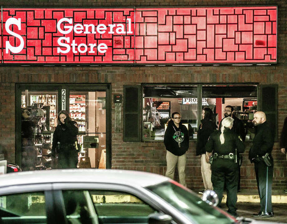 Alton police officers speak to potential witnesses outside of Casey's General Store, 1517 Washington Ave., Alton, Friday night after the report of an armed robbery. Photo: Nathan Woodside   The Telegraph