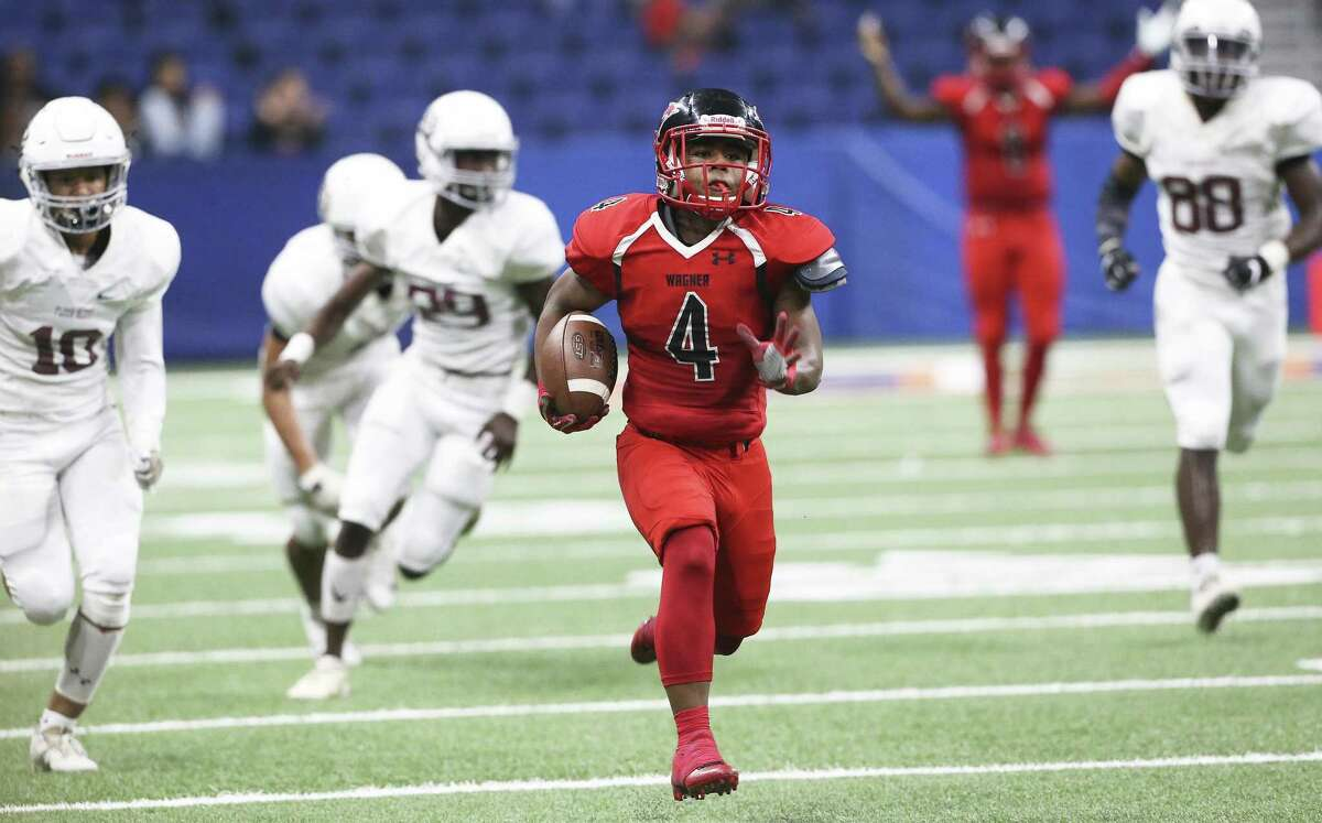 Thunderbird slot back Karlton Black turns on his speed and leaves the field behind for a touchdow for the Thunderbirds as Wagner takes on Flour Bluff in third round high school football playoff action at the Alamodome on November 30, 2018.