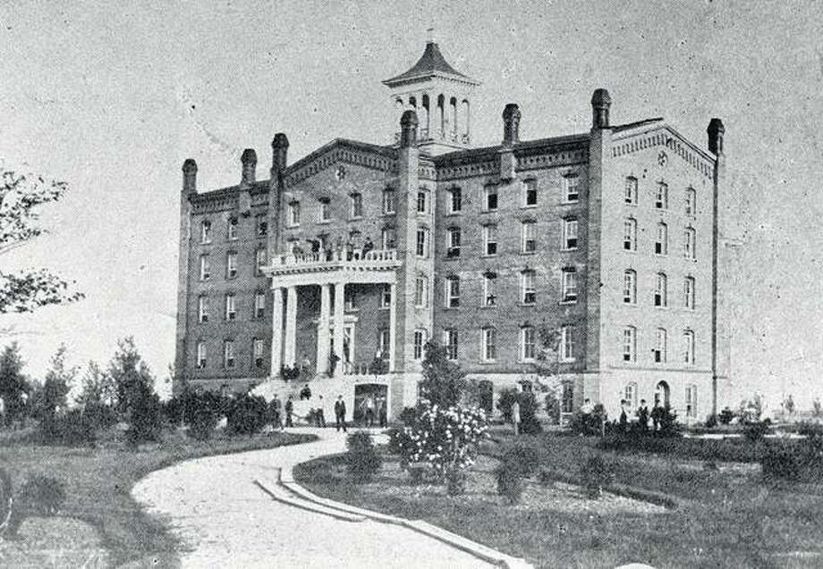 "The Old Dormitory, a former seminary, was the first building used by Illinois Industrial University when it opened in 1867. The five-story building, located where the Beckman Institute now stands, was the largest building in the twin cities and was dubbed the ""Elephant."" It was torn down in 1881. Photo: UI Archives"