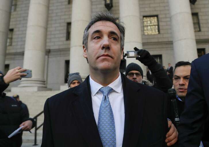"""Michael Cohen walks out of federal court, Thursday, Nov. 29, 2018, in New York, after pleading guilty to lying to Congress about work he did on an aborted project to build a Trump Tower in Russia., Cohen told the judge he lied about the timing of the negotiations and other details to be consistent with Trump's """"political message."""" (AP Photo/Julie Jacobson)"""