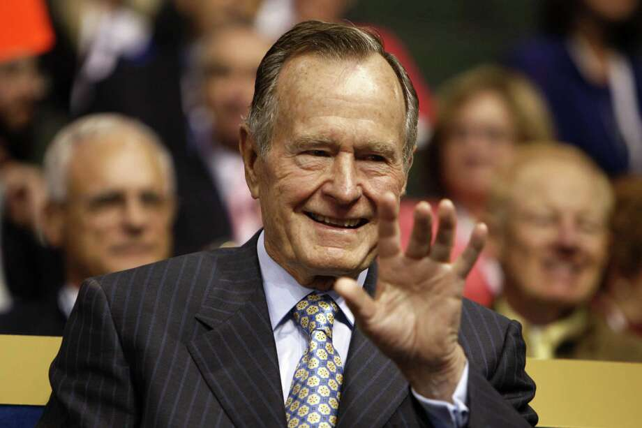 "FILE: Former U.S. President George H.W. Bush acknowledges the audience on day two of the Republican National Convention (RNC) at the Xcel Energy Center in St. Paul, Minnesota, U.S., on Tuesday, Sept. 2, 2008. George H.W. Bush, the U.S. president who fashioned a restrained response to the Soviet Union's collapse and assembled the multinational coalition that liberated Kuwait from an Iraqi invasion, hoping that would be a model for ""a new world order,"" has died. He was 94. Photographer: Joshua Roberts/Bloomberg Photo: JOSHUA ROBERTS / Bloomberg / © 2018 Bloomberg Finance LP"