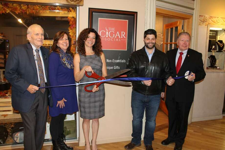 The Cigar Social held a grand opening at Main Street Market in Middletown redently. The shop sells premium cigars, cigar accessories and men's gifts. From left are Middlesex County Chamber President Larry McHugh, Lisa Melaven from the Downtown Business District, Owner Ericka Whalen, Middletown Mayor Dan Drew and Chamber Chairman Jay Polke. Photo: Contributed Photo