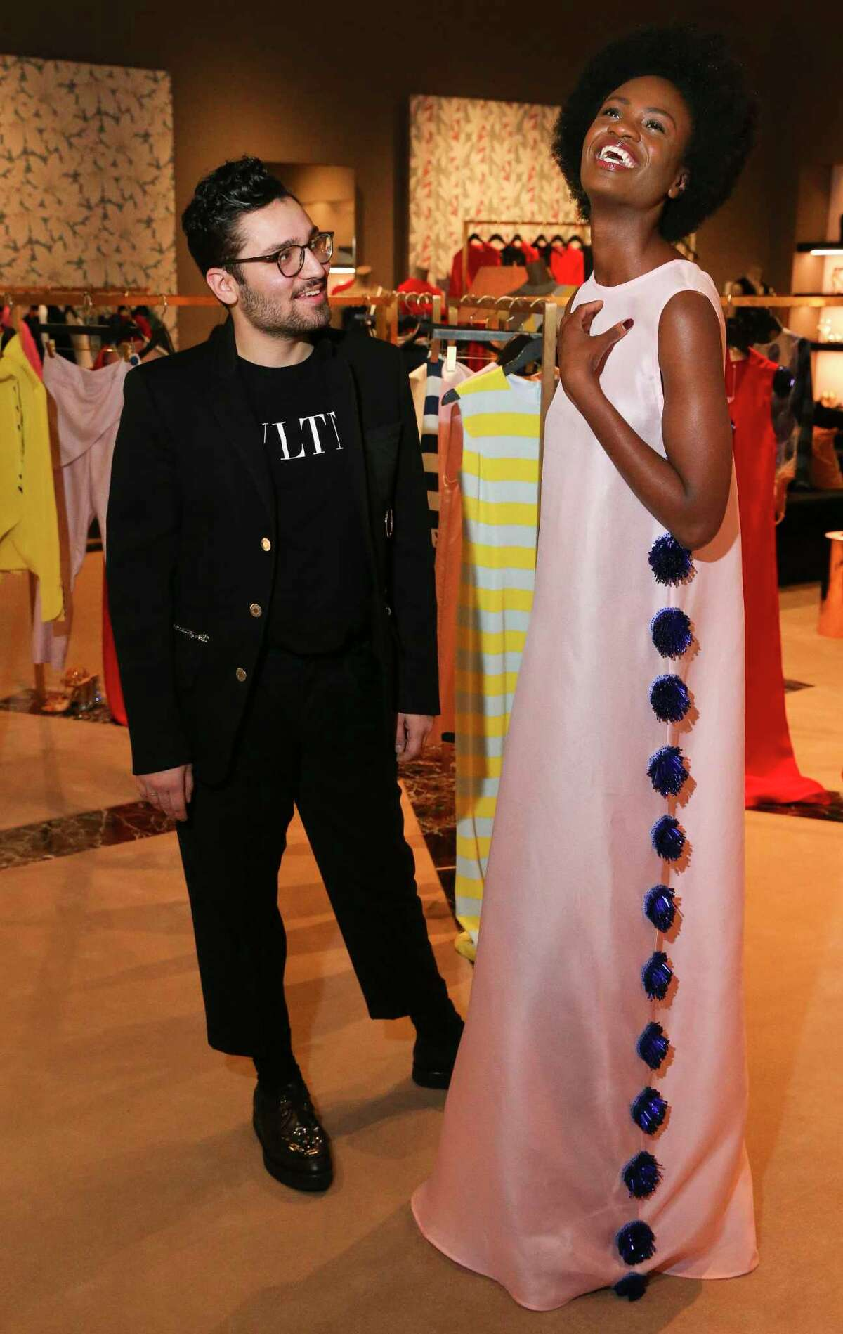 Young Houston fashion designer Amir Taghi and model Raliat Akinlolu pose for a photograph with his new holiday collectionat at The Webster on Thursday, Nov. 29, 2018, in Houston.
