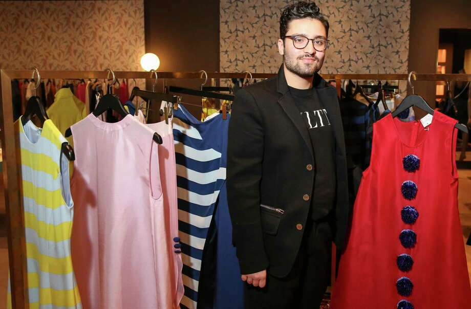 Young Houston fashion designer Amir Taghi poses for a photograph with his new holiday collectionat at The Webster on Thursday, Nov. 29, 2018, in Houston. Photo: Yi-Chin Lee, Staff Photographer / © 2018 Houston Chronicle