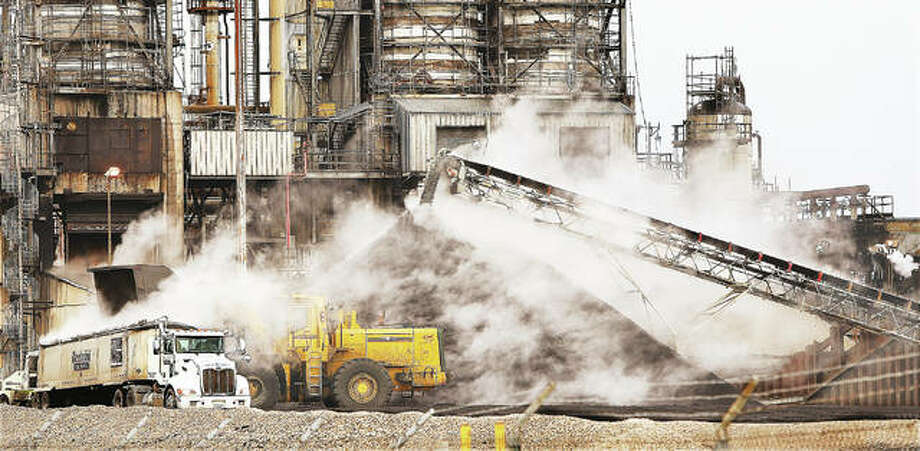 There was a steaming pile of petroleum coke this week next to a cracking unit at the Valero Energy refinery in Hartford. The very high carbon, solid material is sold off and after further processing is often used by the steel and aluminum industries. Photo: John Badman | The Telegraph