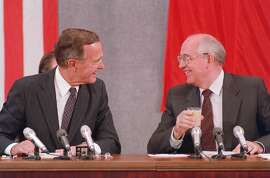 """(FILES) In this file photo taken on July 31, 1991 shows US President George Bush (L) and Soviet counterpart Mikhail Gorbachev laugh during their joint press conference 31 July 1991 in Moscow concluding the two-day US-Soviet Summit dedicated to the disarmament. - Former US president George H.W. Bush, who helped steer America through the end of the Cold War, has died at age 94, his family announced late Friday November 30, 2018. """"Jeb, Neil, Marvin, Doro and I are saddened to announce that after 94 remarkable years, our dear Dad has died,"""" his son, former president George W. Bush, said in a statement released on Twitter by a family spokesman. (Photo by Mike FISHER / AFP)MIKE FISHER/AFP/Getty Images"""
