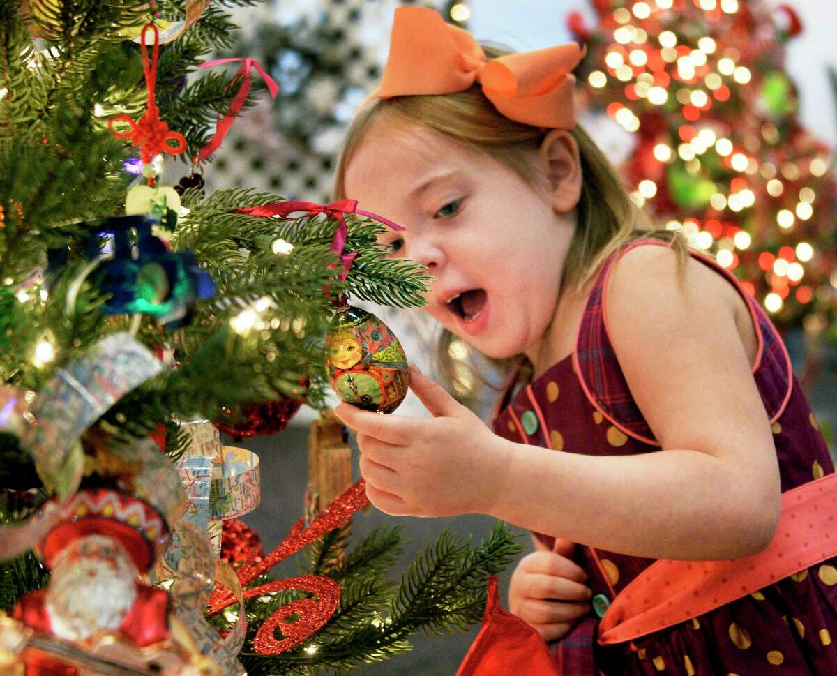 Five-year-old Annabelle Ellithorpe of Saratoga Springs marvels at the ornaments during the Festival of Trees at the Saratoga Springs City Center Saturday Dec. 1, 2018 in Saratoga Springs, NY. (John Carl D'Annibale/Times Union)