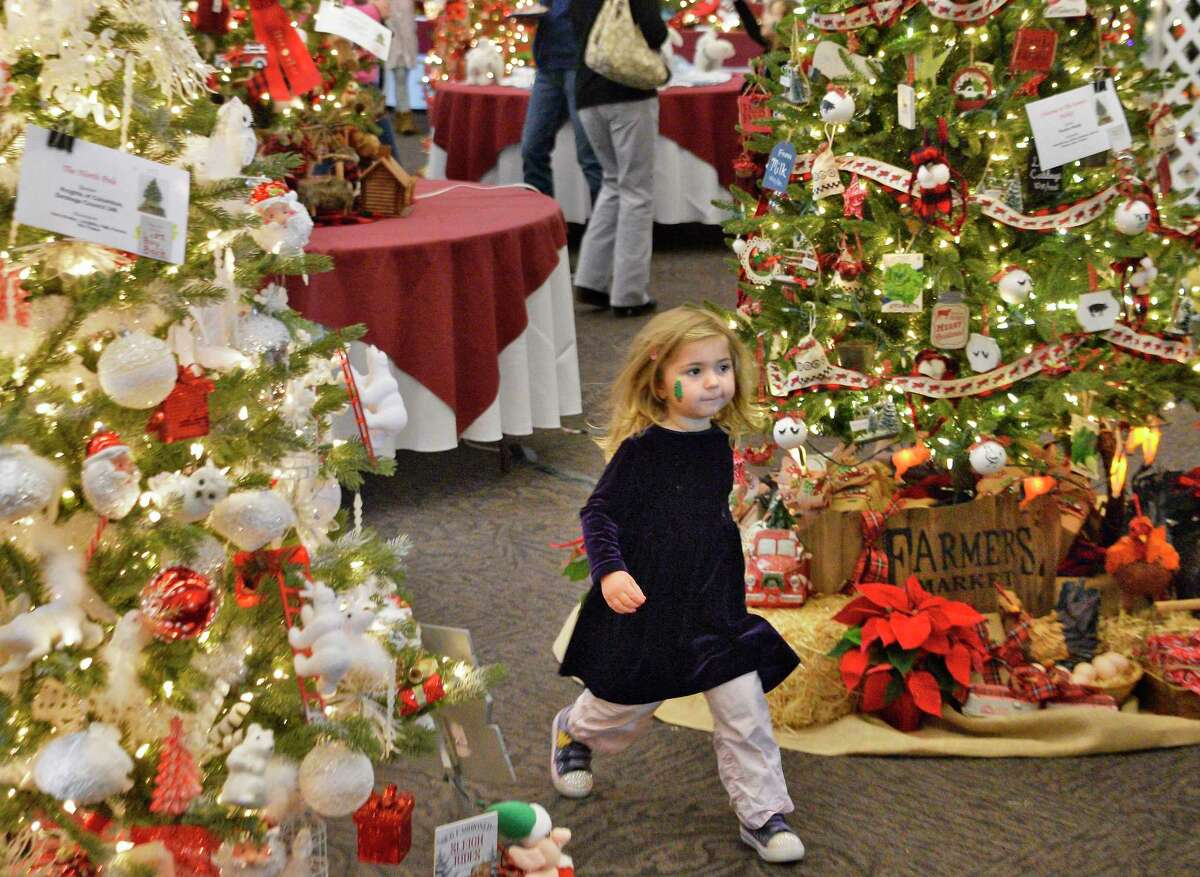 Three-year-old Avery Fayette of Mechanicville strolls through the display at the Festival of Trees at the Saratoga Springs City Center Saturday Dec. 1, 2018 in Saratoga Springs, NY. (John Carl D'Annibale/Times Union)