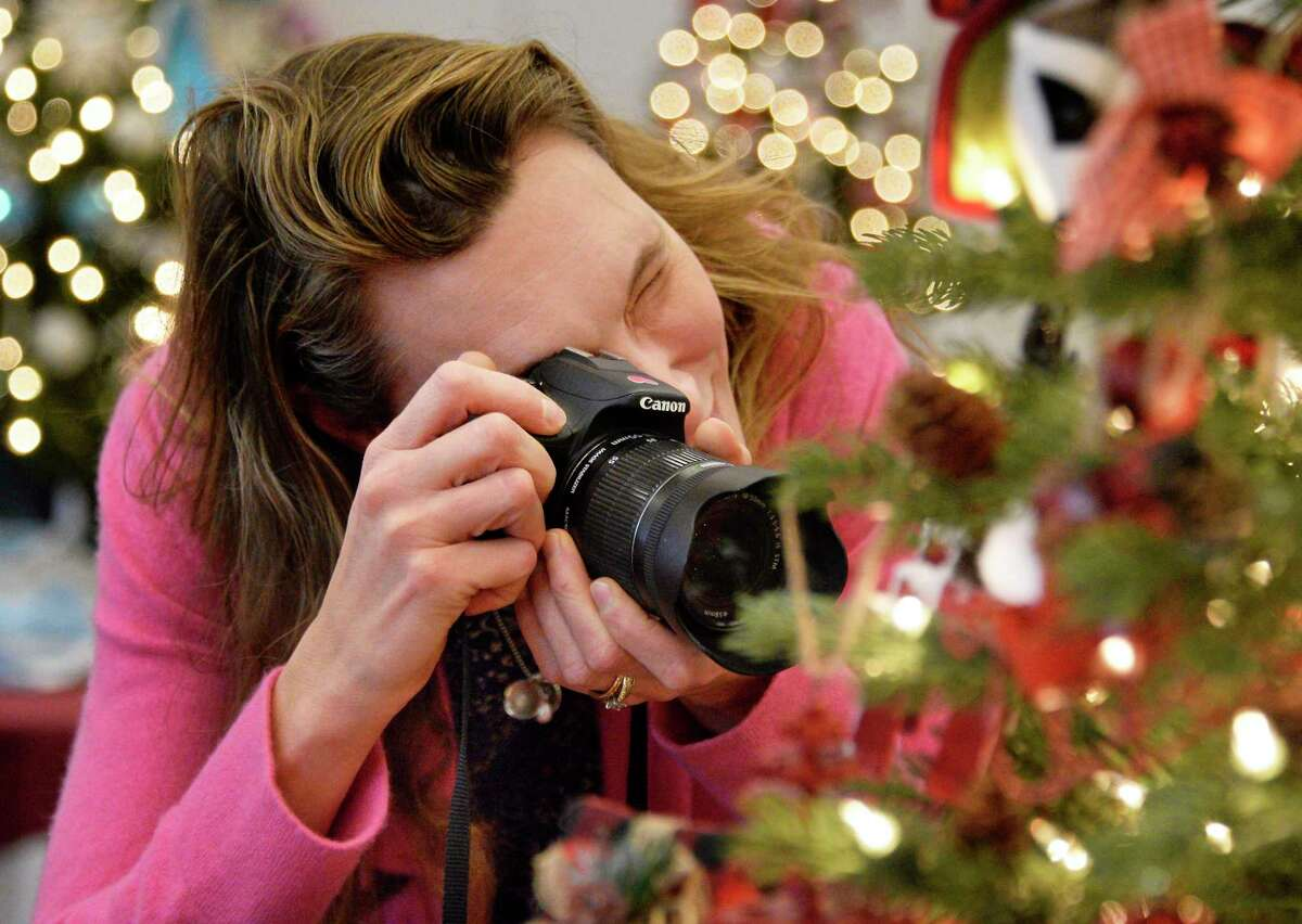 Sara Stankovich of Wilton photographs ornaments during the Festival of Trees at the Saratoga Springs City Center Saturday Dec. 1, 2018 in Saratoga Springs, NY. (John Carl D'Annibale/Times Union)