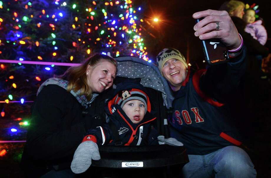 Norwalk residents Elise and Craig Ackerman and their son, Austin, 1, take a selfie during the Norwalk City Hall Holiday Tree Lighting Celebration Friday, November 30, 2018, on the front lawn of City Hall in Norwalk, Conn. Photo: Erik Trautmann / Hearst Connecticut Media / Norwalk Hour