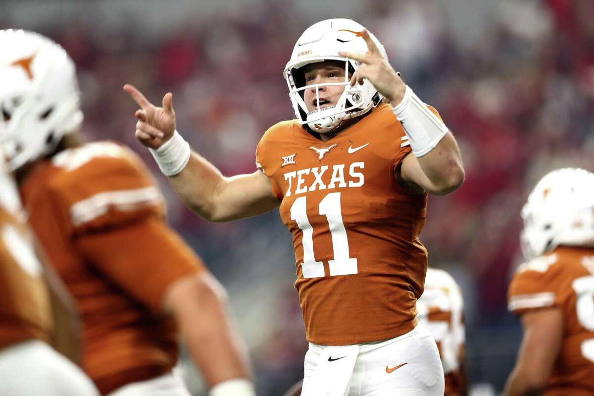 ARLINGTON, TEXAS - DECEMBER 01: Sam Ehlinger #11 of the Texas Longhorns celebrates his touchdown run against the Oklahoma Sooners in the first quarter at AT&T Stadium on December 01, 2018 in Arlington, Texas.