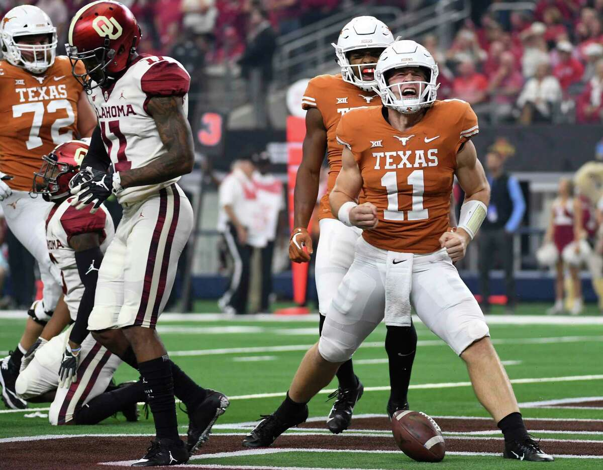 Texas quarterback Sam Ehlinger (11) celebrates after scoring on a touchdown run against Oklahoma on the opening drive of the Big 12 Conference championship NCAA college football game on Saturday, Dec. 1, 2018, in Arlington, Texas. (AP Photo/Jeffrey McWhorter)
