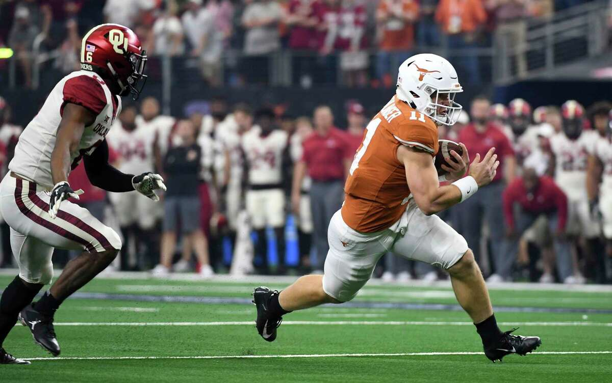 Texas quarterback Sam Ehlinger (11) gets past Oklahoma cornerback Tre Brown (6) on a touchdown run during the first half of the Big 12 Conference championship NCAA college football game on Saturday, Dec. 1, 2018, in Arlington, Texas. (AP Photo/Jeffrey McWhorter)