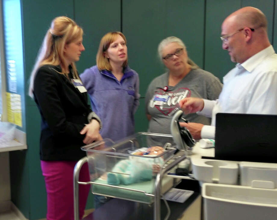 Above, Maico representative, Brad Hunter, walks Newborn Nursery Staff, Cassie Martin, RN; Tara Pond, RN and Tamara McCasland, RN through Covenant Health Plainview's new infant hearing screening machine. Photo: Covenant Health Plainview/Courtesy Photo