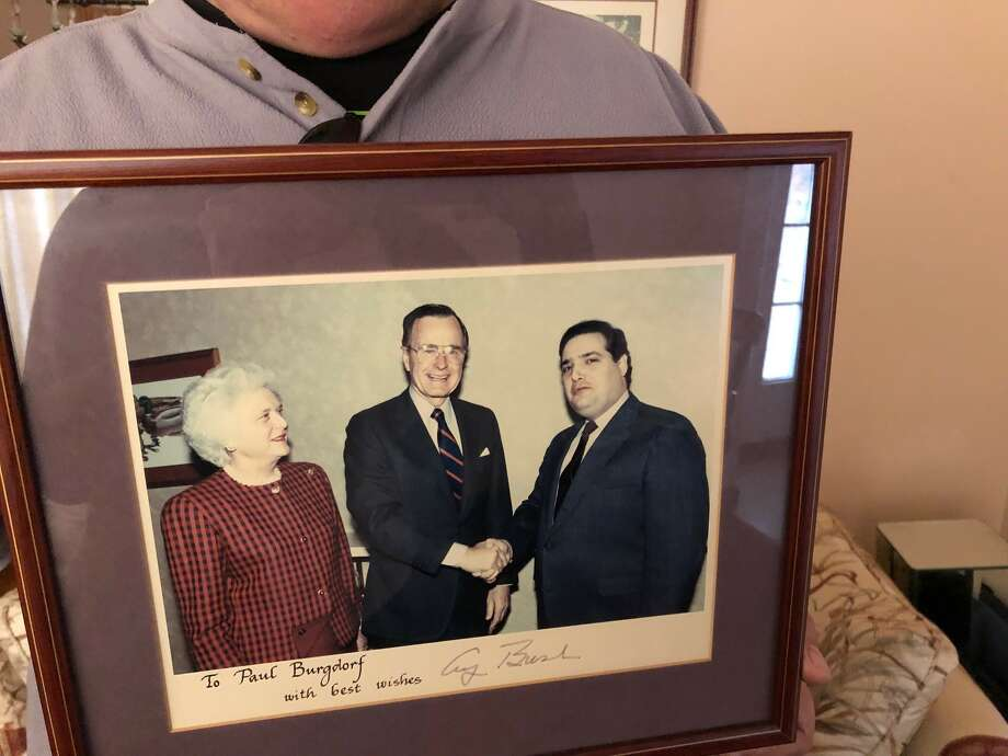 Paul Burgdorf, 63, poses with a photo of his 1988 meeting with President George H.W. Bush and First Lady Barbara Bush. Burgdorf aided in H.W.'s 1980 run for president, and served as Bush's Capital Region campaign coordinator for the 1988 presidential election. Photo: Provided By Paul Burgdorf